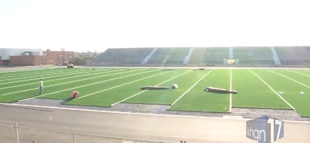 Crews install turf, track at Boggus Stadium