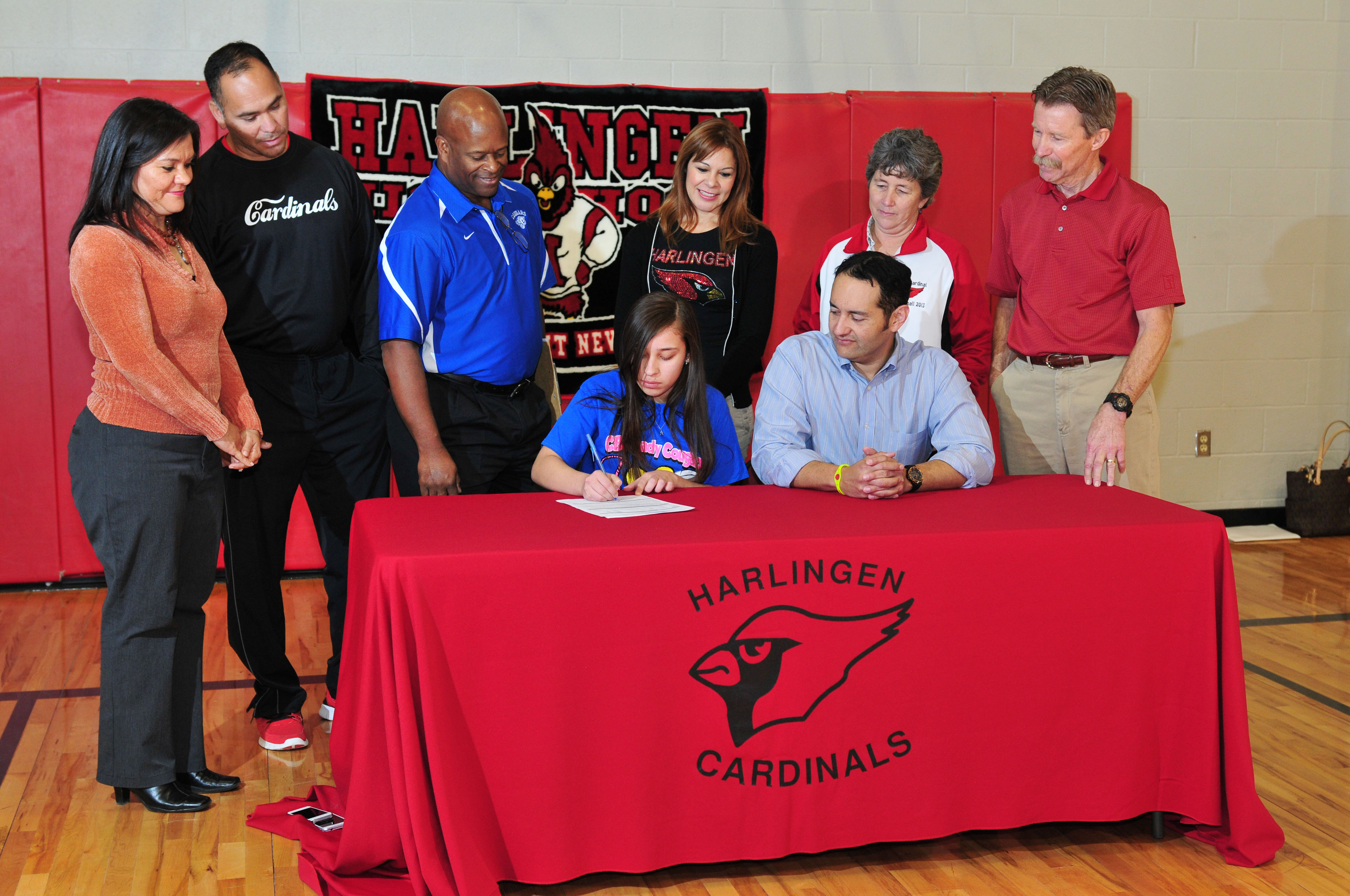 HHS volleyball player signs to play in college