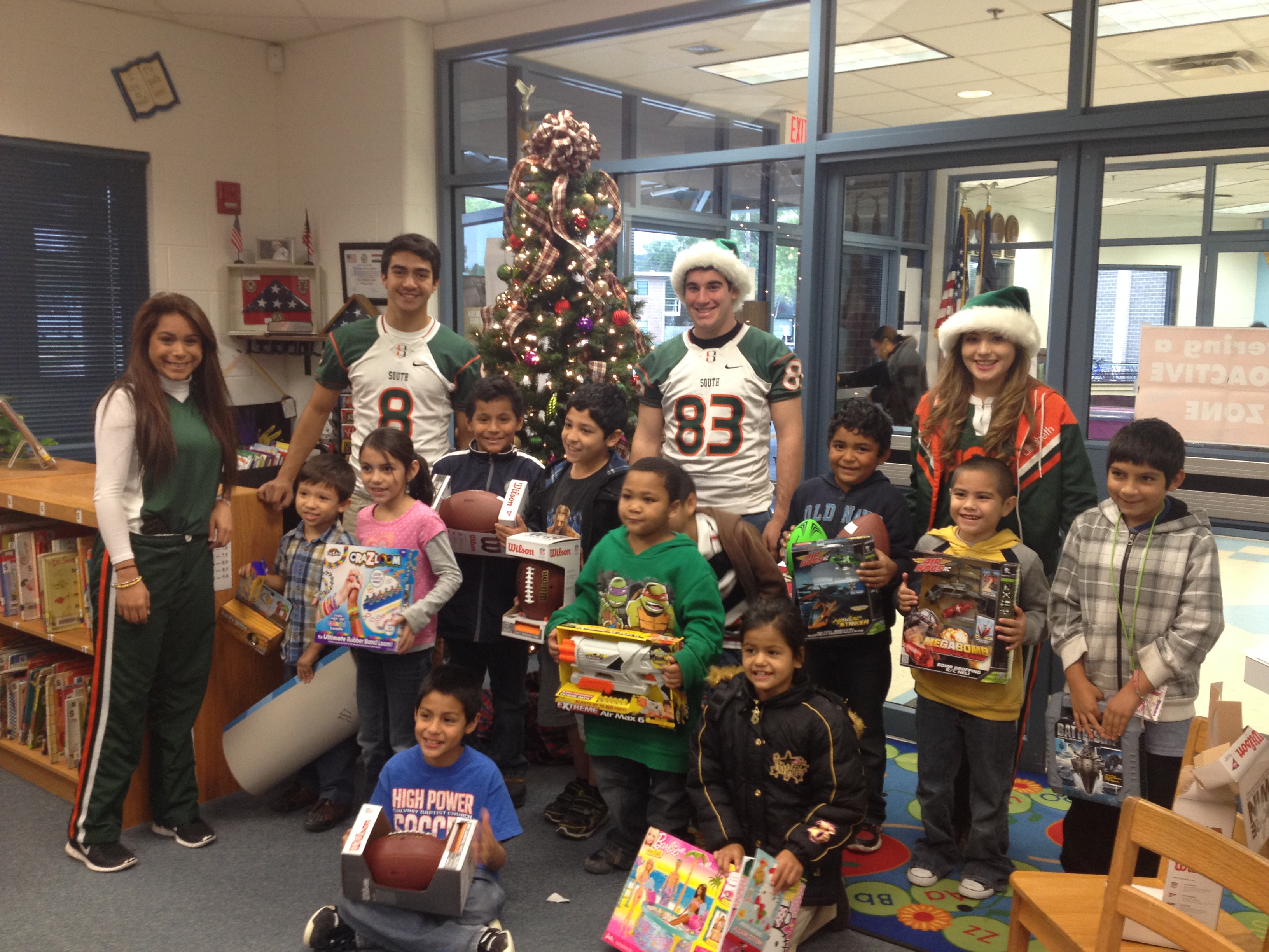 HHSS, Travis and organizations come together to donate over 100 toys to Travis students