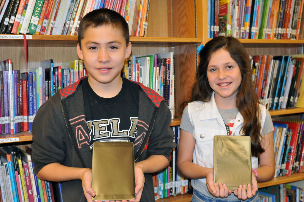 Vela students Austin Andablo and Alyssa Davila celebrate their selection as the winners of semester's iPad minis in Nov.