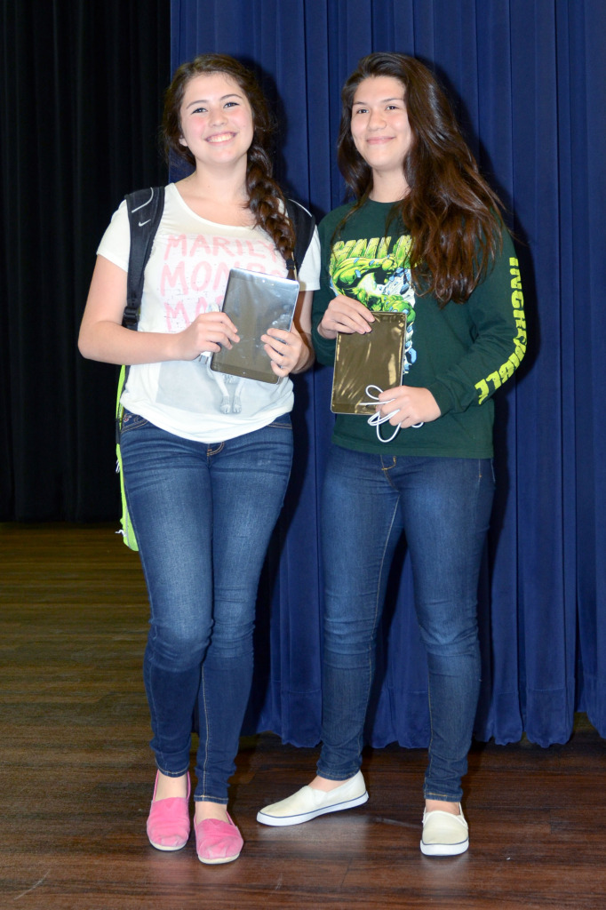 Cano Freshman Academy students show off their prize from the campus' quarterly perfect attendance ceremony.