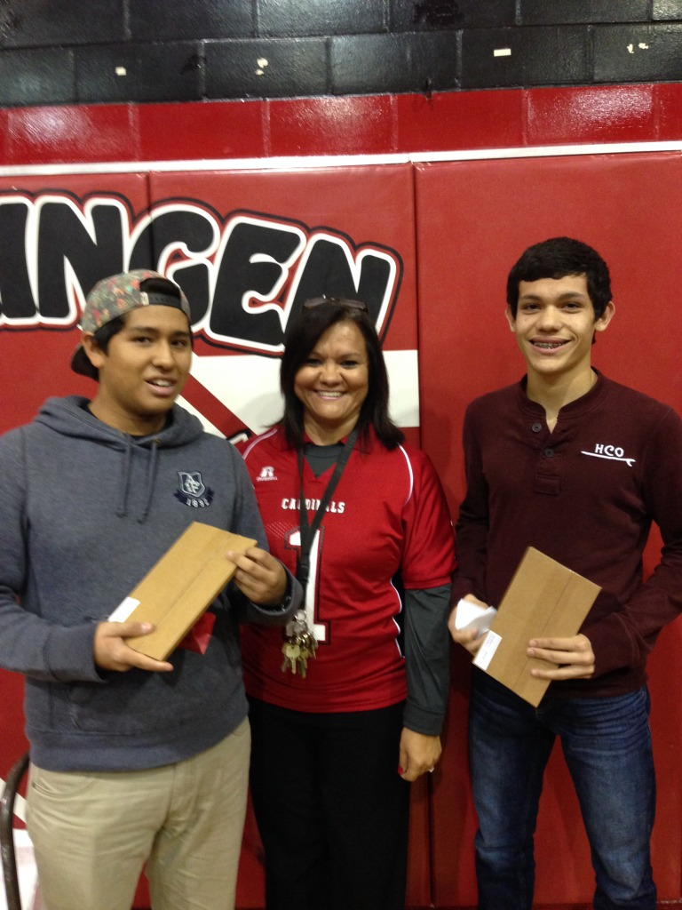 HHS students Matthew Gonzales and Cohen Reyes celebrate perfect attendance with iPad minis.