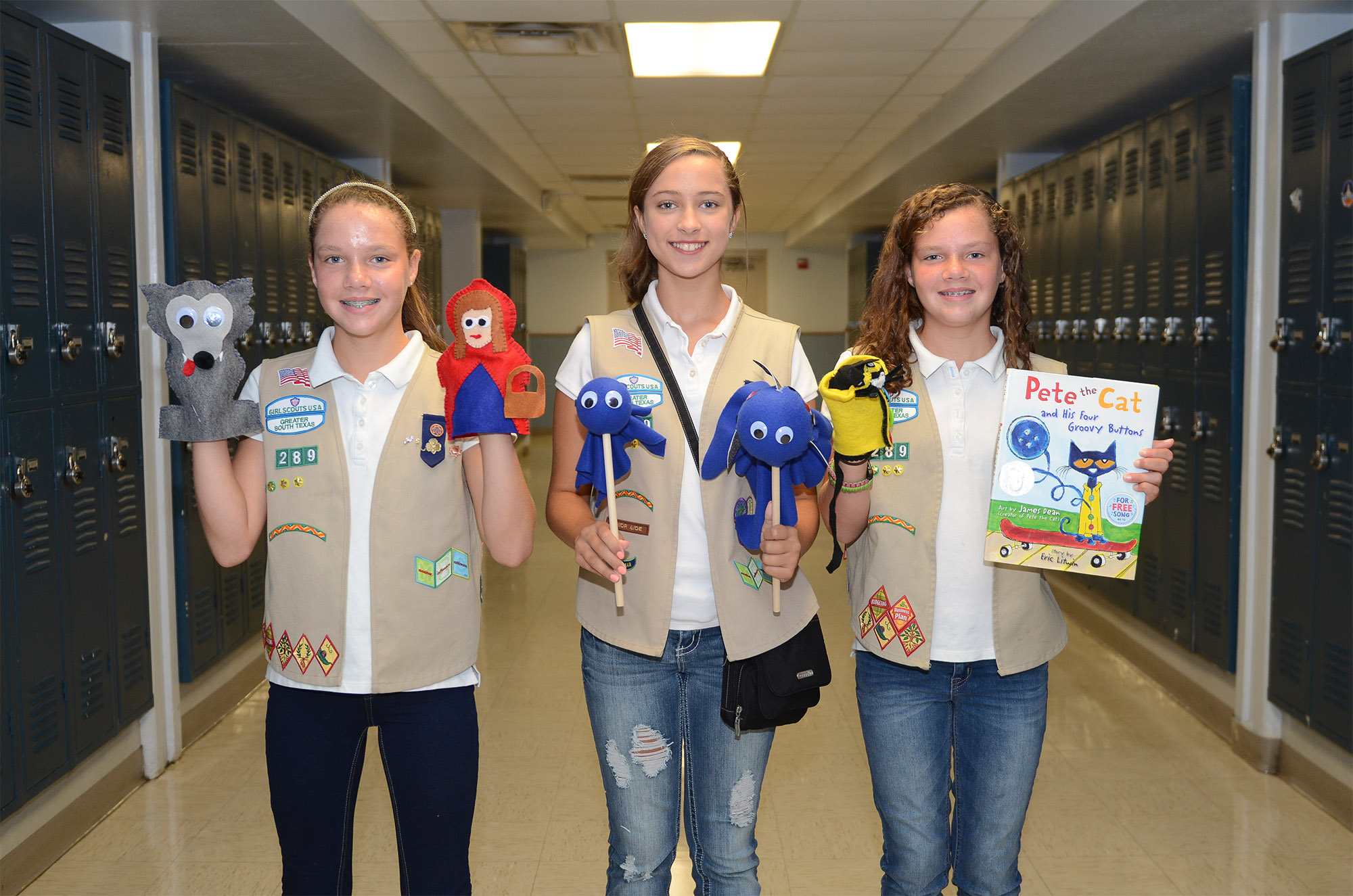 Girl Scout Silver Award candidates complete puppet literacy kits project