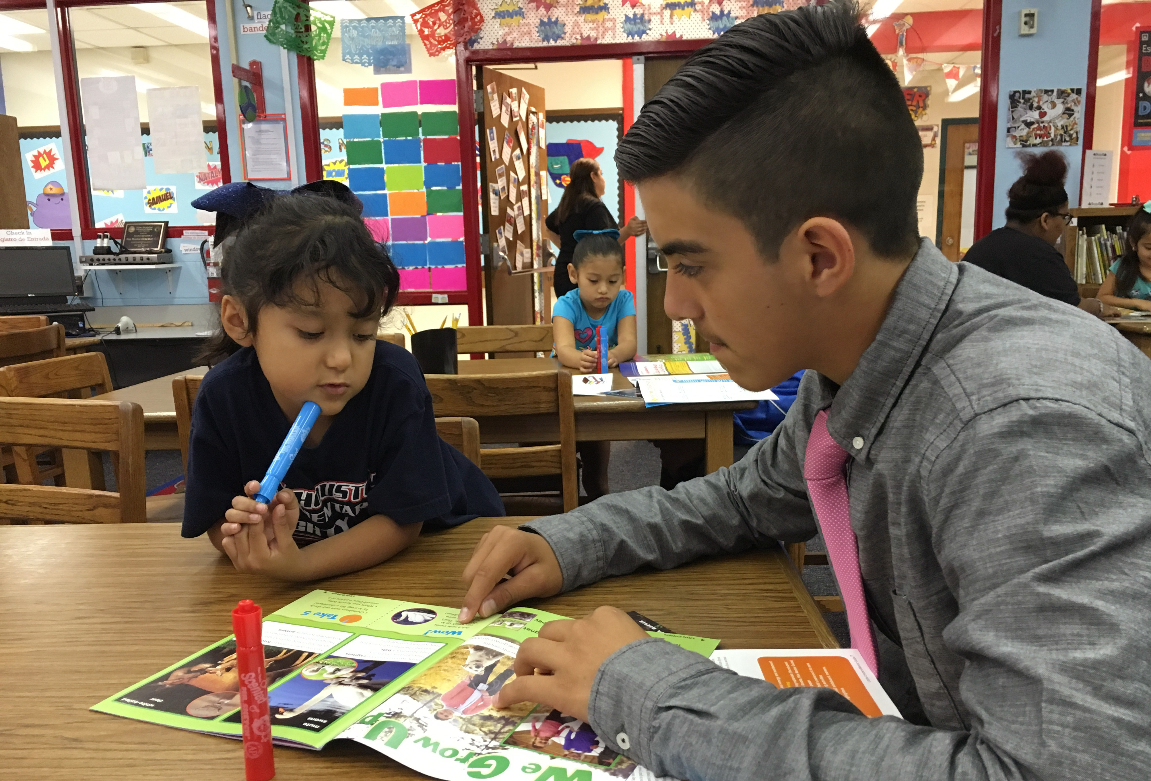 Mentor reading program brings together Coakley and Houston students