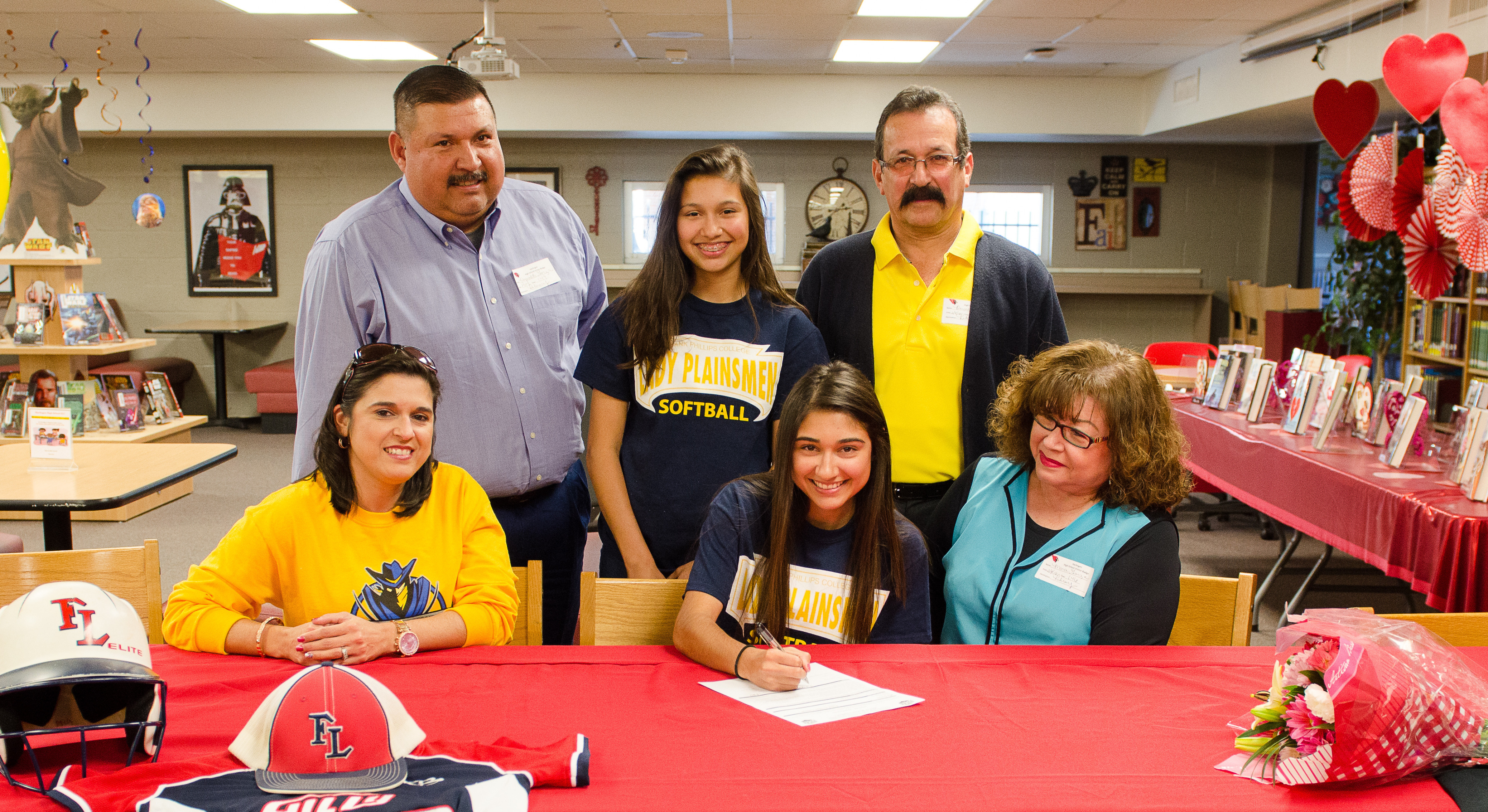 HHS athlete signs to play college softball