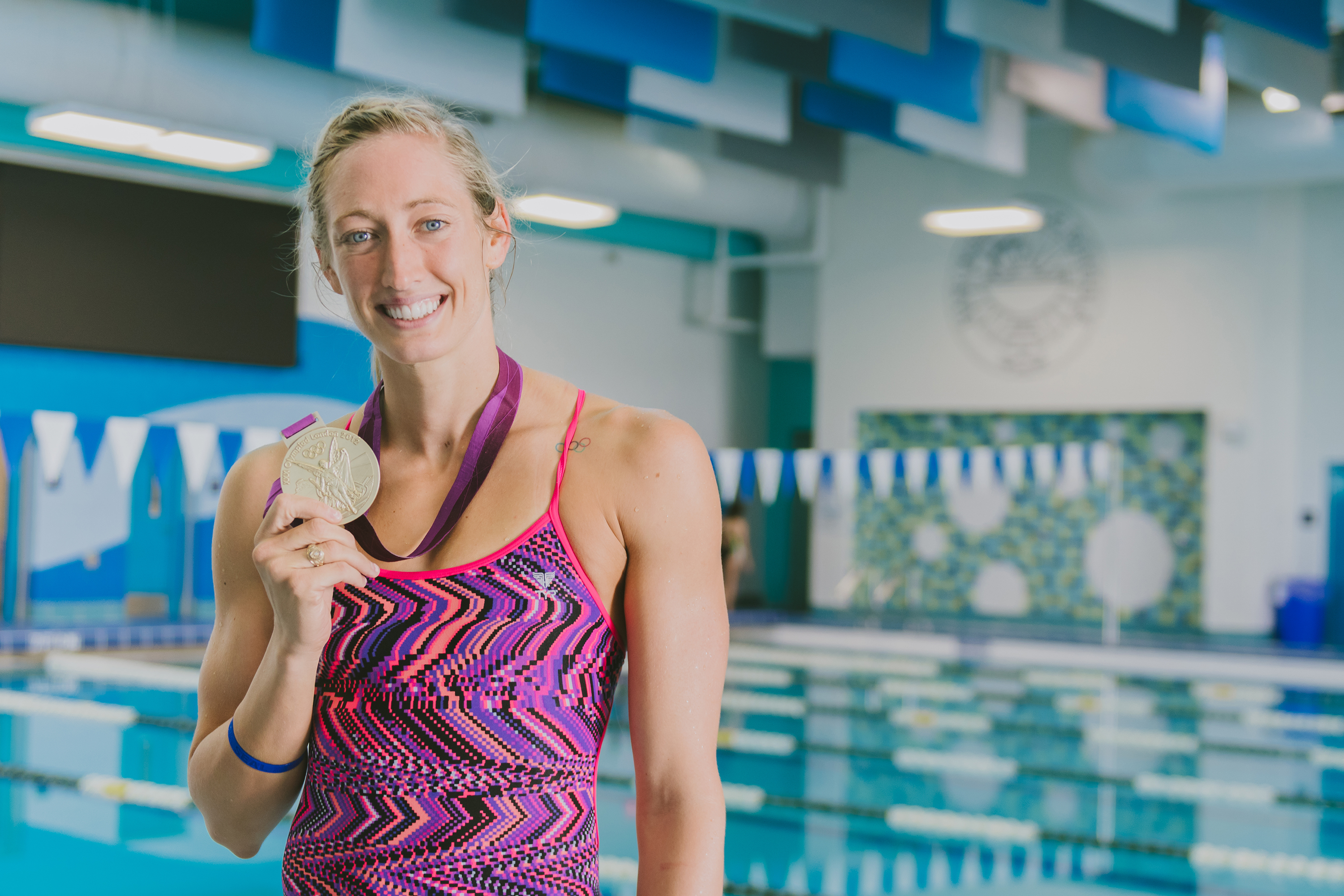 The heart of a champion: Olympic gold medalist shares inspirational message with HCISD swimmers